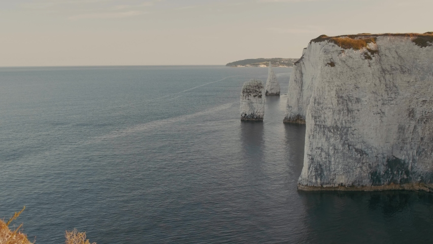 Static shot of the white cliffs and rugged coastline of Jurassic Coast near Dorset, UK | Shutterstock HD Video #1054725200