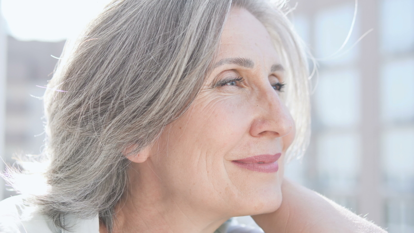 Beautiful wrinkled woman sincerely smiling, enjoying happy active life, aging