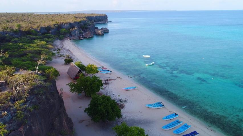 Boats on beach of Bahia de las Aguilas, Dominican Republic. Aerial view | Shutterstock HD Video #1054725932