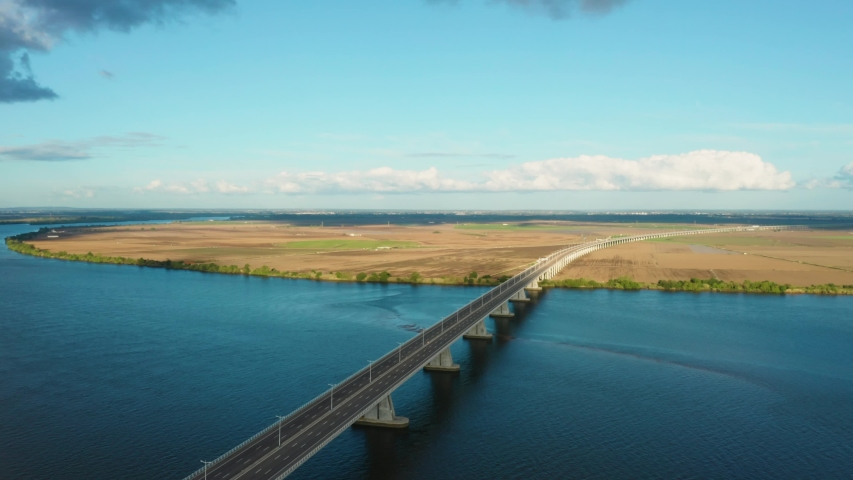 Aerial shot of a bridge crossing river tagus in portugal | Shutterstock HD Video #1054725962