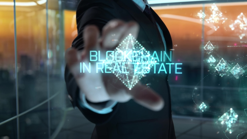 Blockchain in Real Estate chosen by businessman in technology hologram concept | Shutterstock HD Video #1054726421