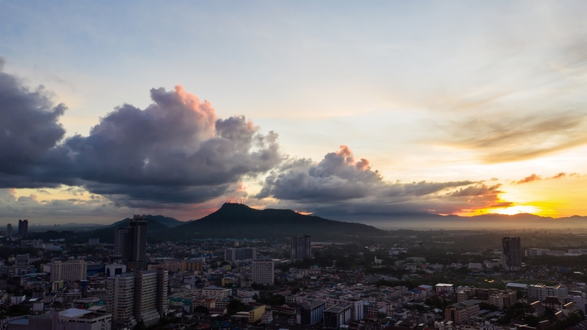 Footage B roll of Aerial view drone Hyperlapse timelapse cityscape with sky sunrise over the mountain. hyperlapse time lapse sky and clouds at sunrise. hyper lapse office building cityscape. | Shutterstock HD Video #1054727633