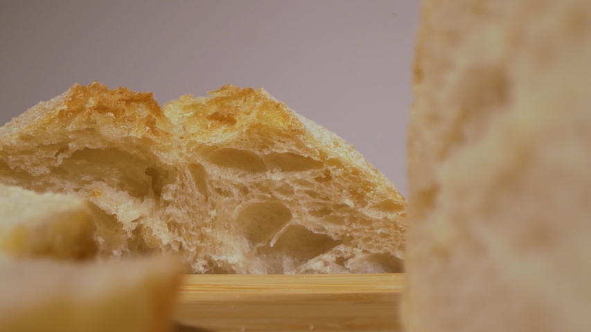 Macro sliding view of sliced ciabatta bread. Probe lens view. | Shutterstock HD Video #1054727804