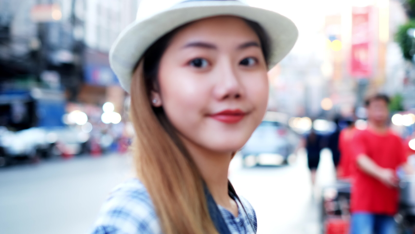 Traveler Asian blogger women travel in Bangkok, Thailand, beautiful female using mobile phone make vlog and live in social media .woman tourist looking camera. | Shutterstock HD Video #1054728413