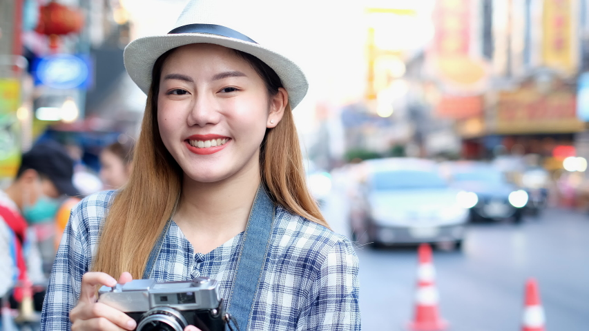 Traveler Asian blogger women travel in Bangkok, Thailand, beautiful female using mobile phone make vlog and live in social media .woman tourist looking camera. | Shutterstock HD Video #1054728416