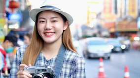 Traveler Asian blogger women travel in Bangkok, Thailand, beautiful female using mobile phone make vlog and live in social media .woman tourist looking camera.