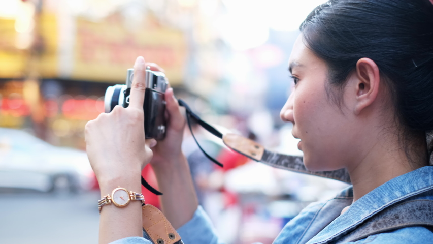 Traveler Asian blogger women travel in Bangkok, Thailand, beautiful female using mobile phone make vlog and live in social media .woman tourist looking camera. | Shutterstock HD Video #1054728419