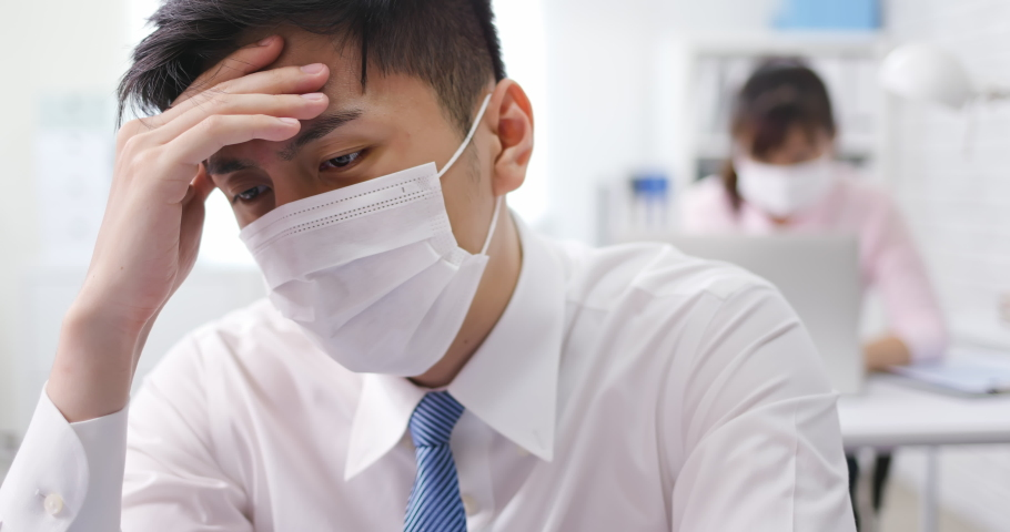 Asian young businessman has headache or feel depress in office