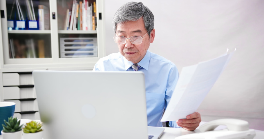 Asian senior CEO businessman is working in the office   Shutterstock HD Video #1054728932