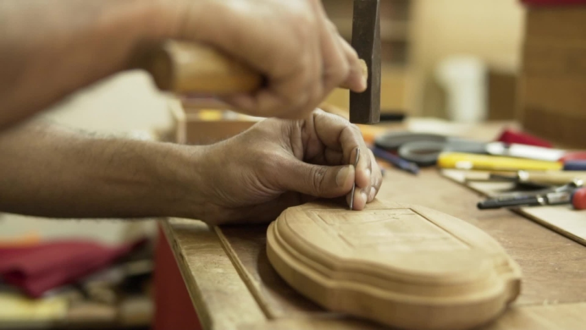 Man is making wooden picture with nail and hammer. Slowmotion. | Shutterstock HD Video #1054729163