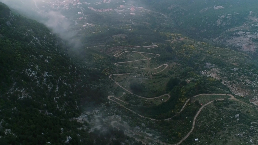 Aerial Drone Shot Of Winding Road By Mountain In Remote Lebanon