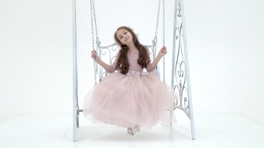 Charming Long Haired Girl in Nice Dress Swinging on Elegant Swing   Shutterstock HD Video #1054729673