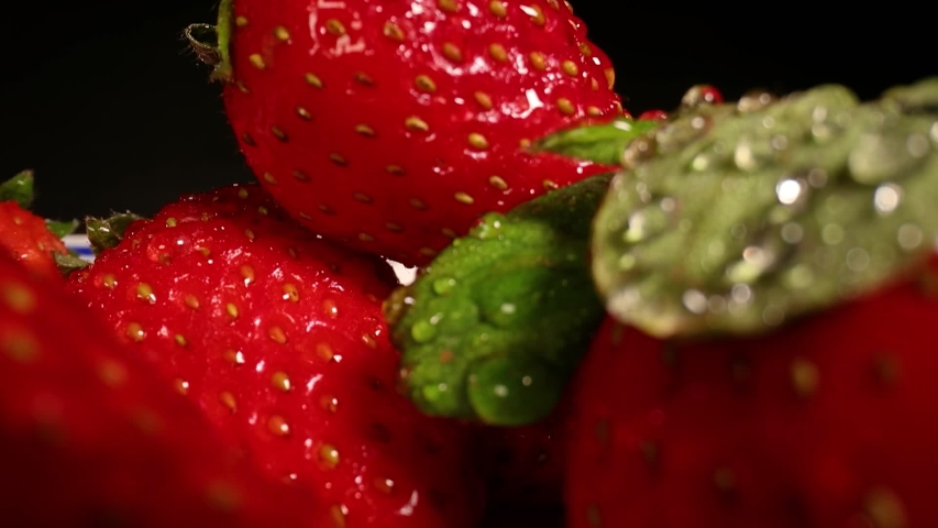 Strawberries in a pile wide angle macro sliding shot | Shutterstock HD Video #1054729811