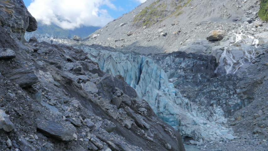 Fox glacier in New Zealand descends from the Southern Alps down into temperate rainforest just 300 meters above sea level.