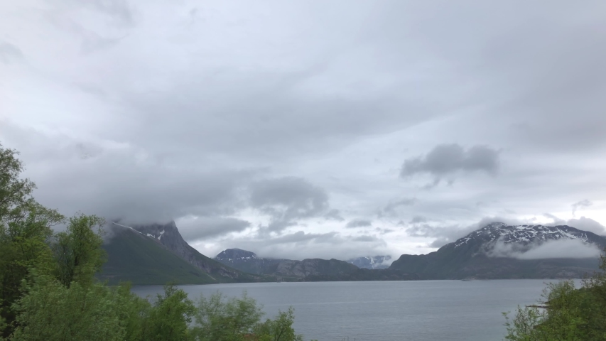 Timelapse of cloudy weather around amazing mountain of Helgeland in northern Norway   Shutterstock HD Video #1054729898