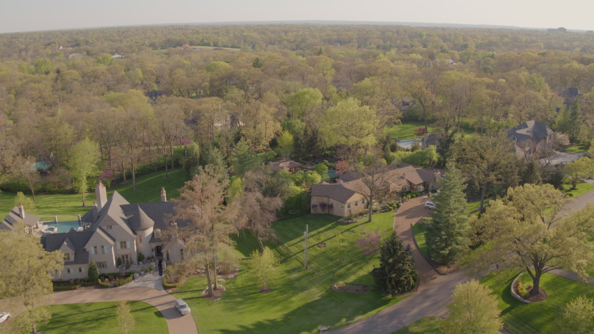 Push forward over beautiful homes in upscale neighborhood in St. Louis, Missouri on a beautiful spring day. | Shutterstock HD Video #1054729970