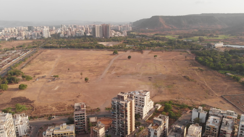 A aerial drone shot of an empty land or ground in the middle of the city, Navi Mumbai, India