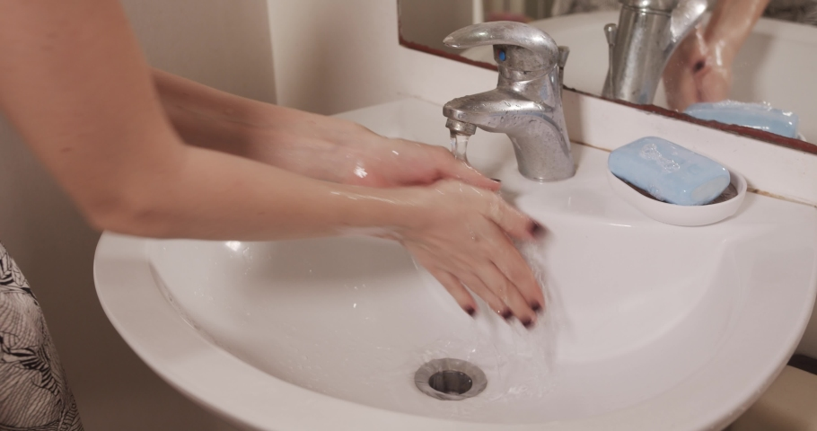 Washing hands with a soap | Shutterstock HD Video #1054730819
