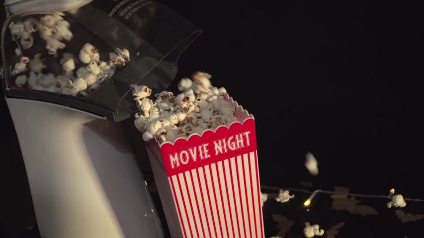 Popcorn maker popping popcorn at an in home movie theater. | Shutterstock HD Video #1054731053