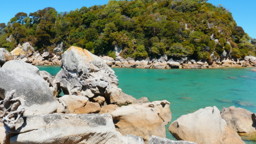 Loved for its turquoise water and golden sand beach, the sunny town of Kaiteriteri is a launching place for trips into the Abel Tasman National Park.   Shutterstock HD Video #1054731071