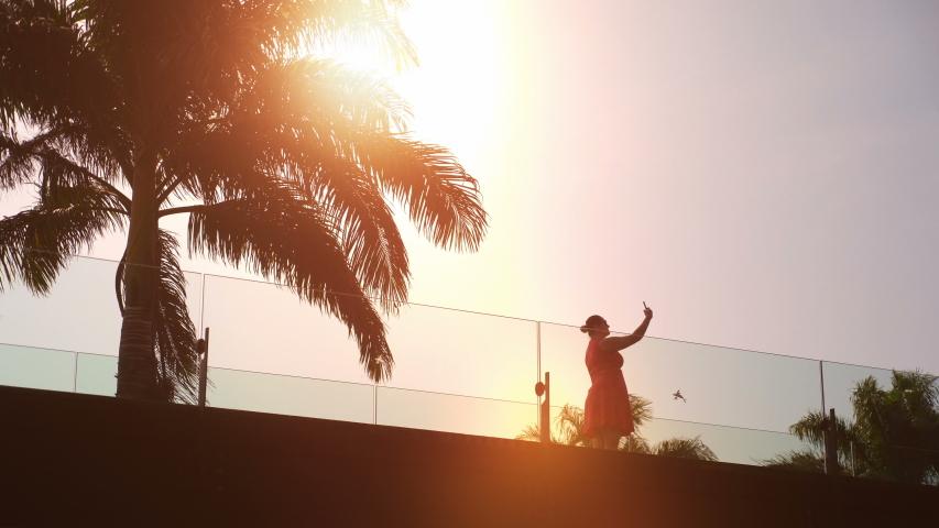 Woman taking a selfie photo on a viaduct in 4K slow motion 60fps | Shutterstock HD Video #1054731170