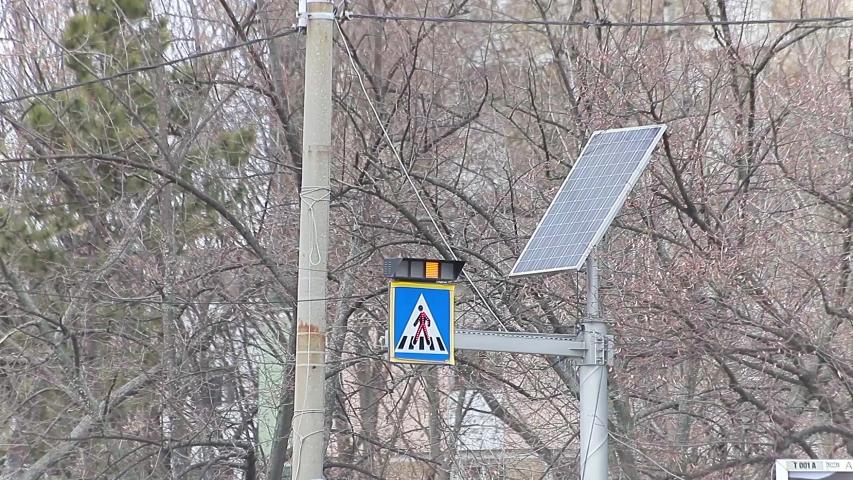 Seamless loop light flashing pedestrians crossing zebra sign solar cells | Shutterstock HD Video #1054731308