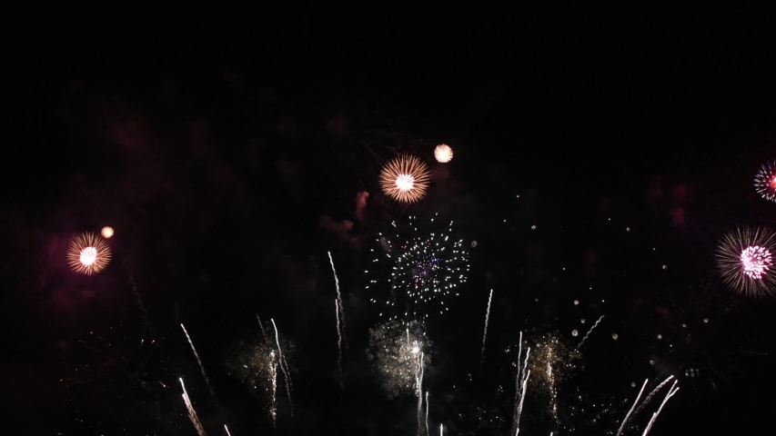 Colorful of fireworks for 4th July national holiday festival,independence day concept  | Shutterstock HD Video #1054731692