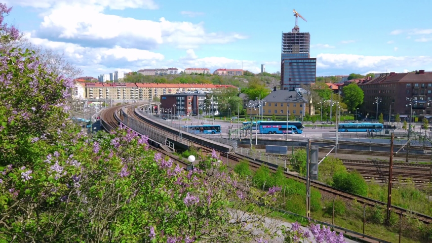 Urban view of Gothenburg with public buses and high rise building under construction | Shutterstock HD Video #1054732157