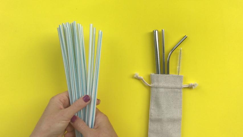 Save planet. Plastic straws vs metal reusable. Shot on a phone   Shutterstock HD Video #1054732706
