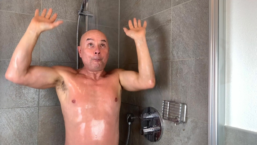 Funny bald man dancing in the shower under running water, concept of cleanliness, sanitation, lifestyle, good mood | Shutterstock HD Video #1054732838