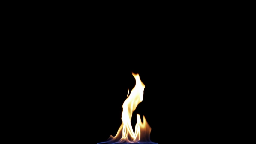 Fire flame Isolated on black background. Fire Flames Igniting And Burning Slow Motion. A line of real flames ignite on a black background Real fire. Perfect for the layer with different blending modes