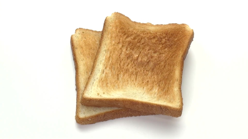 Sliced Toast Bread on white background | Shutterstock HD Video #1054733480