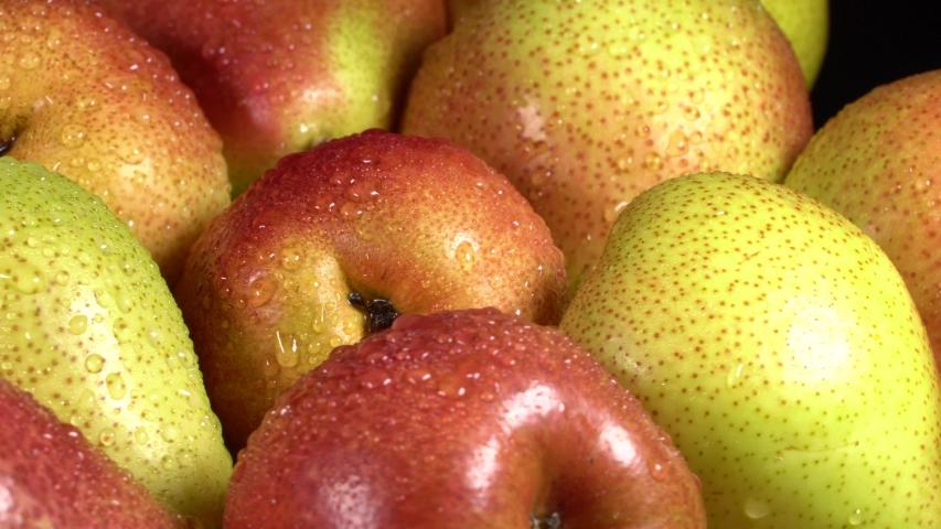 Fresh ripe pears rotate on wood cutting board | Shutterstock HD Video #1054733525
