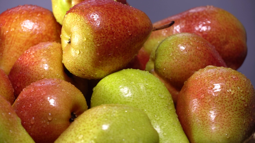 Fresh ripe pears rotate on wood cutting board | Shutterstock HD Video #1054733543