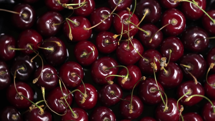 Fresh juicy red cherry berry rotate. Bird-cherry texture. Top view | Shutterstock HD Video #1054733558