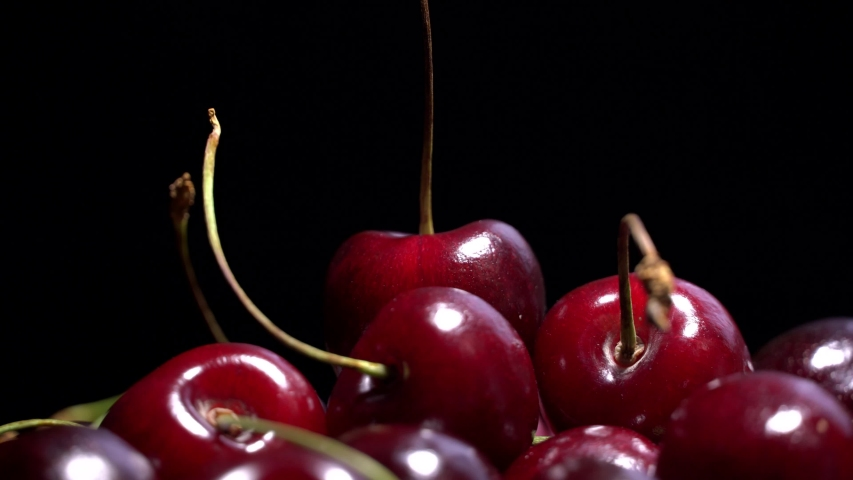 Fresh juicy red cherry berry rotate at black background | Shutterstock HD Video #1054733585
