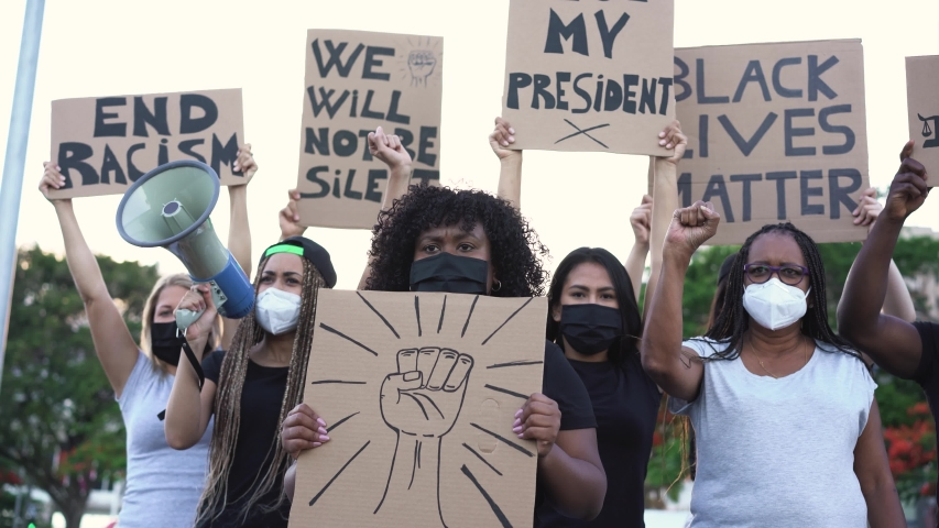 People from different culture and races protest on the street for equal rights - Demonstrators wearing face masks during black lives matter fight campaign - 4K | Shutterstock HD Video #1054733597