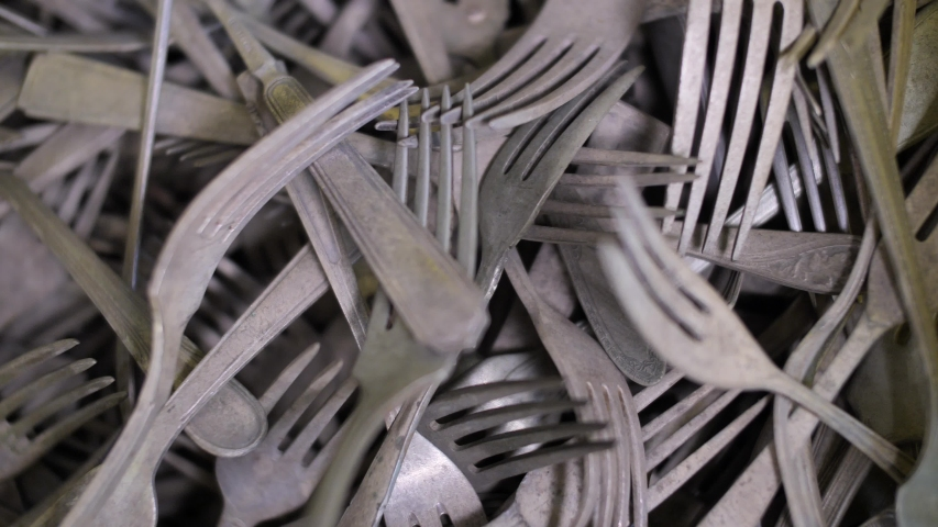 Pile of aged, tarnished forks, mixed design old collectible flatware | Shutterstock HD Video #1054733969