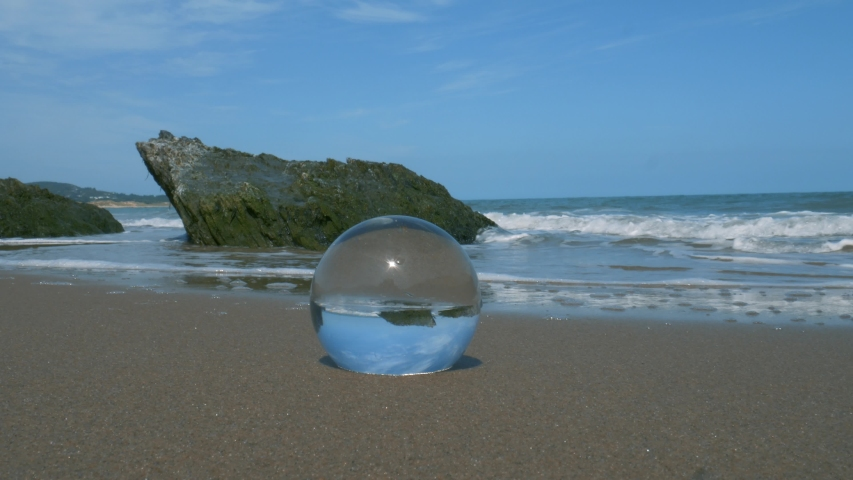 A crystal ball on the sandy beach of Wicklow, Ireland - close up | Shutterstock HD Video #1054733972
