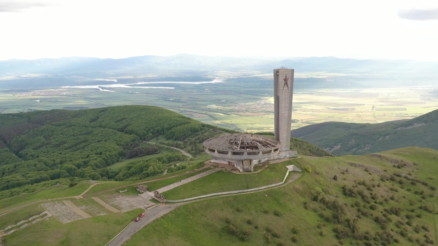 Buzludja, Bulgaria. Dron top view on one of the largest in Europe abandoned communist monuments in the Balkan mountains, Bulgaria. UFO dish style building. Hipster destination in a beautiful mountain. | Shutterstock HD Video #1054733978