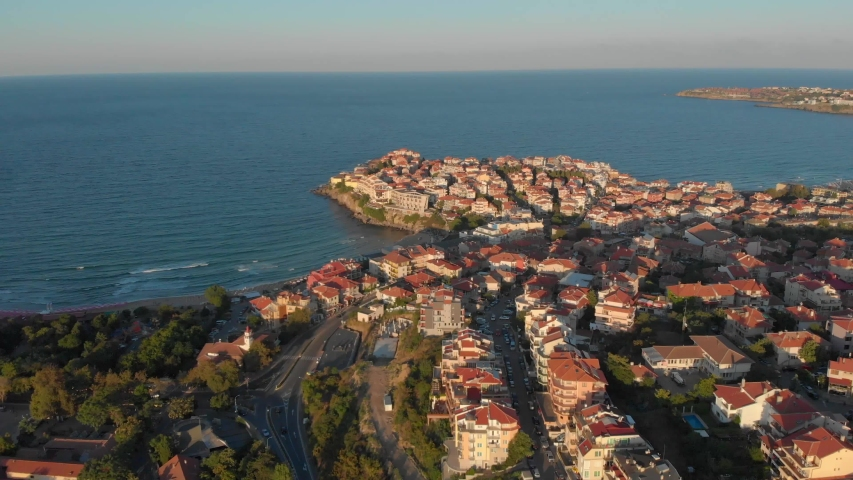 Flying over the beautiful seaside town in Bulgaria during sunset - aerial   Shutterstock HD Video #1054733987