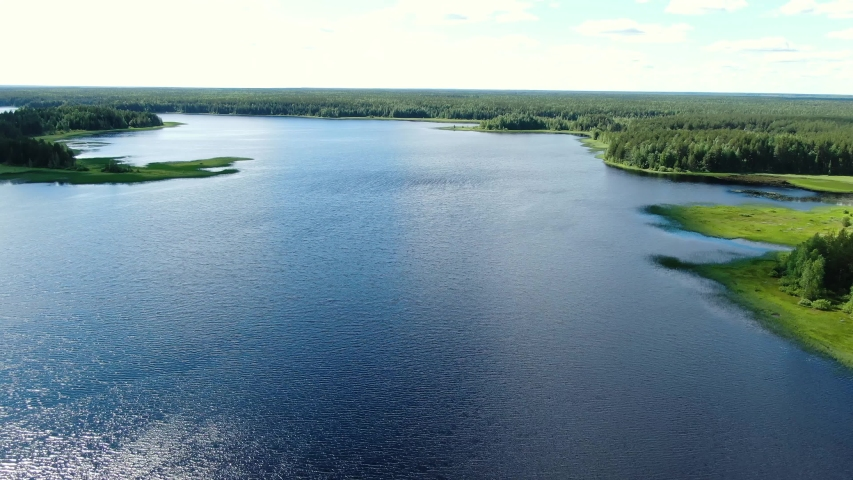 Flight over the taiga forest lake