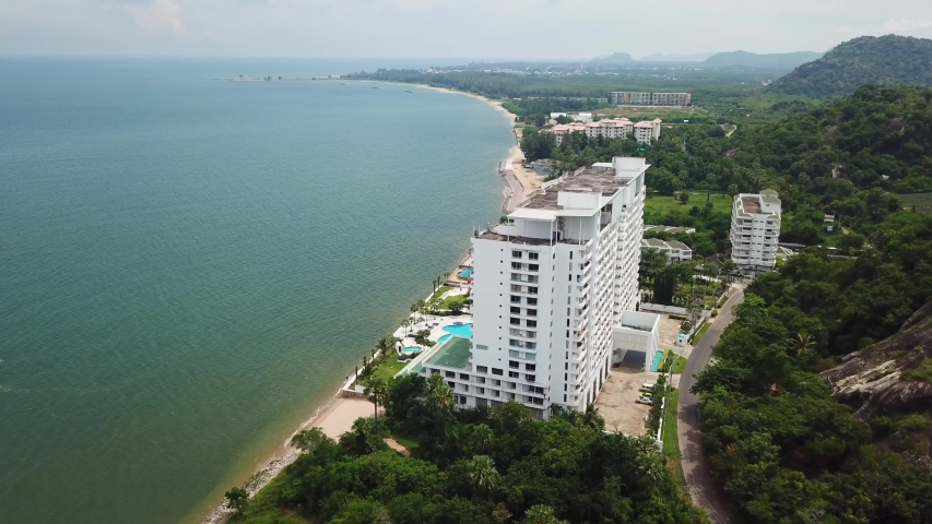 Hua Hin, Prachuap Khiri Khan Province, Thailand. Aerial top view of the sandy beach with green tropical palms, surrounded by ocean | Shutterstock HD Video #1054734119