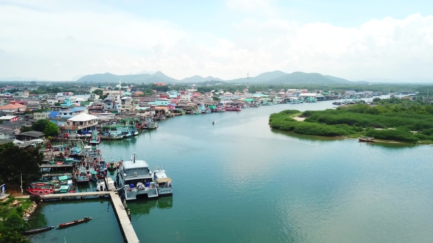 Hua Hin, Thailand. Drone flying over the fisherman boats and amazing blue water | Shutterstock HD Video #1054734137