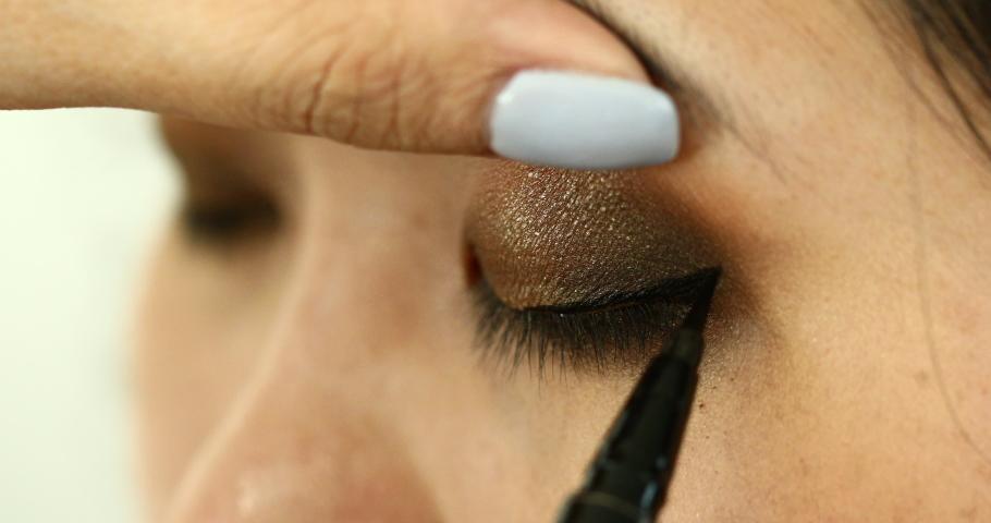 Woman using eye pen makeup beauty eyeliner fashion | Shutterstock HD Video #1054734449