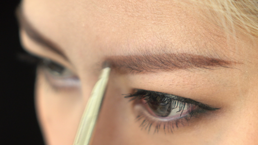 Fashion woman makeup beauty eyebrow | Shutterstock HD Video #1054734461