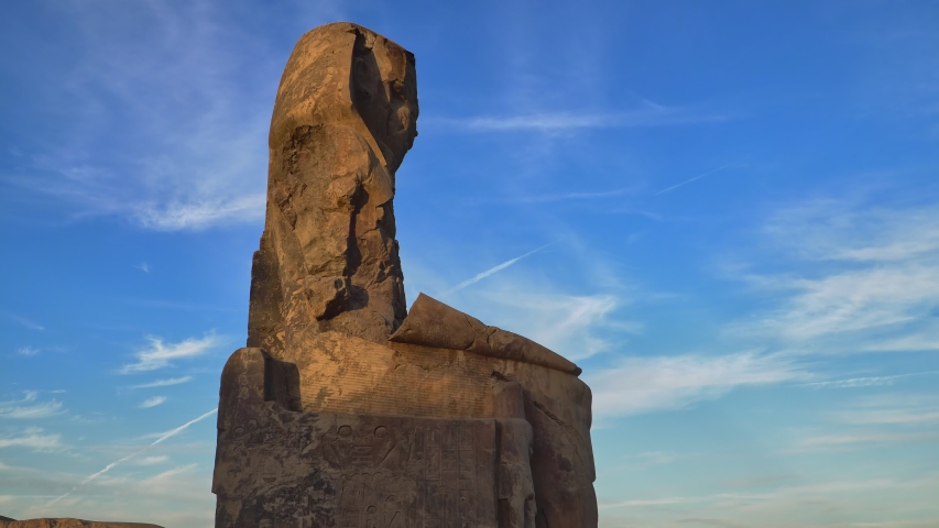 The Colossi of Memnon, two stone massive statues of the Pharaoh Amenhotep III, who reigned in Egypt during the Dynasty XVIII. | Shutterstock HD Video #1054735238