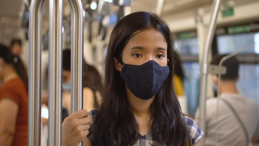 Coronavirus Pandemic: Woman With Medical Mask Inside Train on Commute to Work | Shutterstock HD Video #1054737056