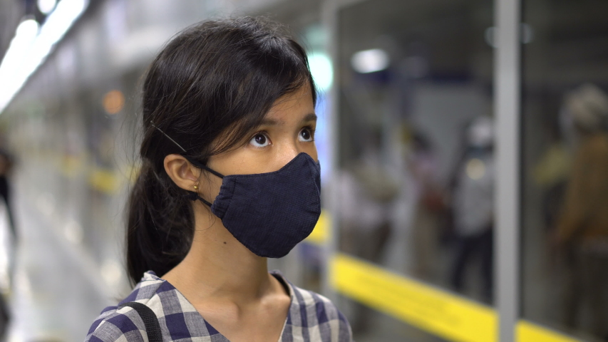 Asian Woman Wearing Face Mask Waiting at Subway Station For Train To Arrive - Public Transport During Coronavirus Pandemic | Shutterstock HD Video #1054737068
