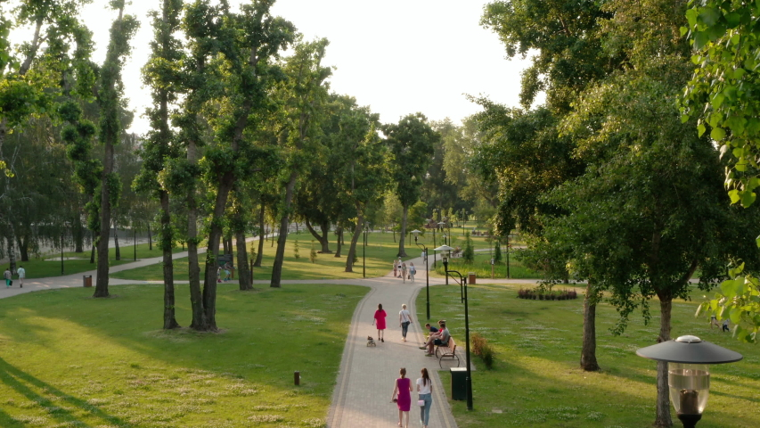 Kiev, Ukraine, June 2020: Aerial view. City park with green trees and grass. People are walking near the city park in Kiev, Ukraine